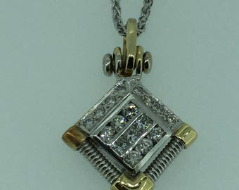"14kt Yellow and White Gold Diamond Pendant .95ctw with a FREE  16"" 14kt White Gold chain"