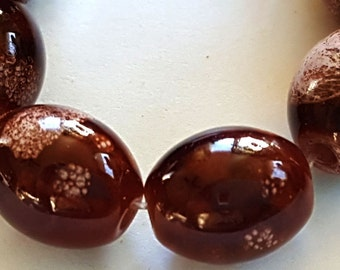 """8mm x 10mm brown and tan oval glass beads - 32"""" strand"""