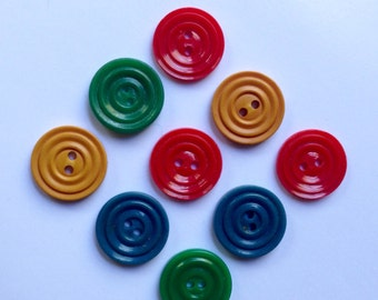 9 vintage early plastic buttons, assorted colours c1930s-50s