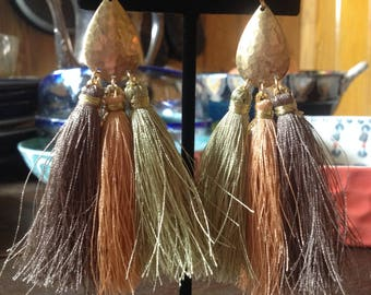 Multi tassel earrings. Earth tone silk tassels on a hammered brass tear drop.