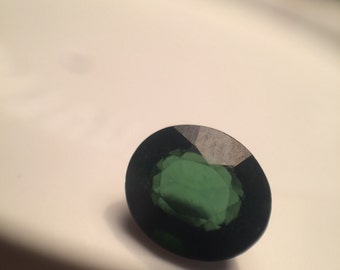 Green oval faceted tourmaline