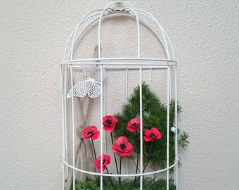 SOLD large flowered cage white placed on a wall frame