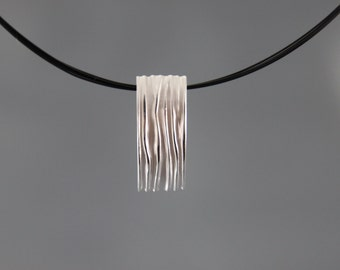 Pendant sterling silver with stripes and folds