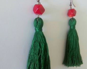 Red account of root of coral and green tassel earrings.