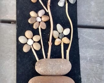Pebble Rock Art: Natural Stone Daisies On Black Felted Board