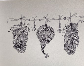 Three Feathers on a beaded string