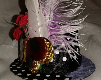 Purple polka dot cat hat with butterfly accent