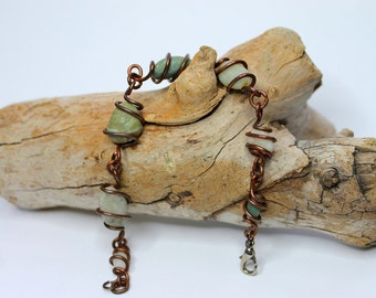 Multi colored wire wrapped beach stone bracelet