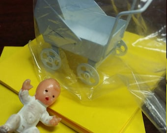 Miniature baby carriage with baby