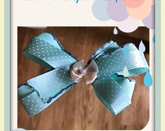 Spring, light blue silk boutique hair bow with white polka dots. Infant, baby, toddler, girl