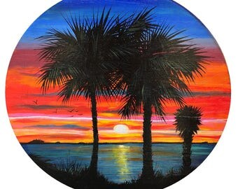 Sunset on the Gulf   sunset on the gulf filled with vibrant tones. Hand painted by Peter Olsen. Solid Wood. Round.