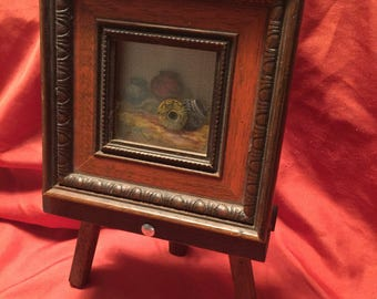 Tiny painting on an easel