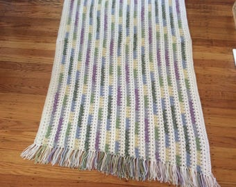 "60""x 33"" throw afghan with fringes"