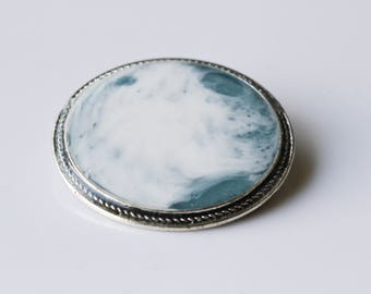 Blue and white resin brooch