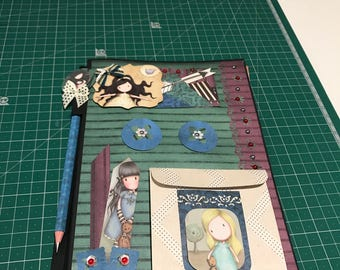 With custom Scrapbook notebook