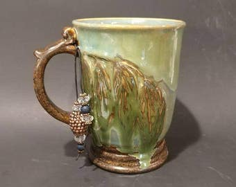 18 oz Weeping Willow leaves Handcrafted Wheel thrown Artisan Pottery Mug with bead bobble.