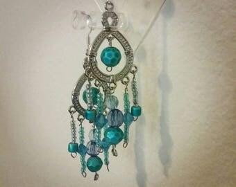 Swing from blue chandelier earrings
