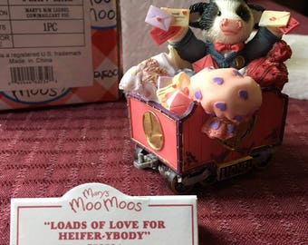Mary Moo Moos Loads of Love for Heifer-ybody Cow on Mail cart with box