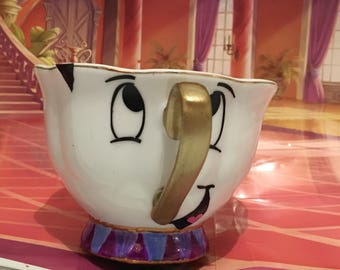 Handmade beauty and the beast inspired teacup, vinyl , paint and ceramic design