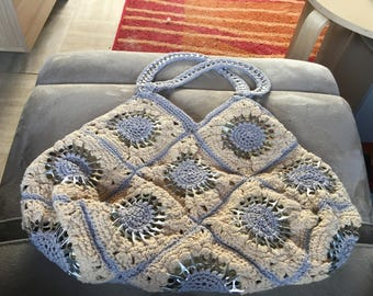 grey/beige bag with pull tabs