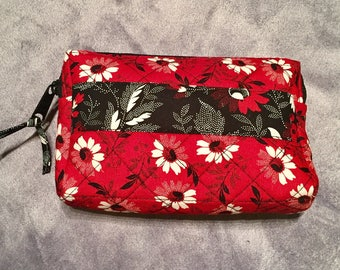 Quilted red and black floral zippered bag