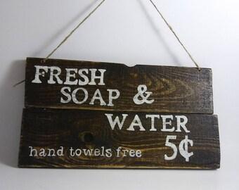 Rustic bathroom sign