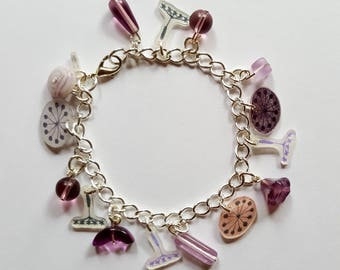 Purple and silver charm bracelet with glass beads and shrink plastic charms