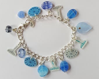Blue charm bracelet with glass beads and shrink plastic charms