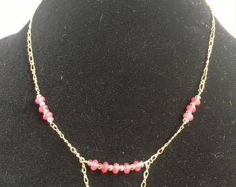 Ruby and gold beaded necklace