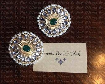 Kundan stud earrings with semi precious green stone