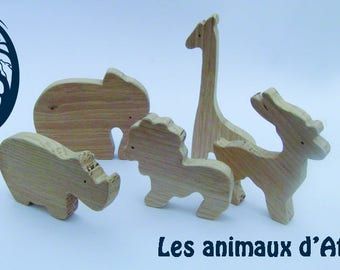 family of 5 African animals in wood (giraffe, gazelle, rhinoceros, elephant and lion)