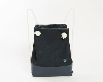 Leather and neoprene backpack with cotton handles