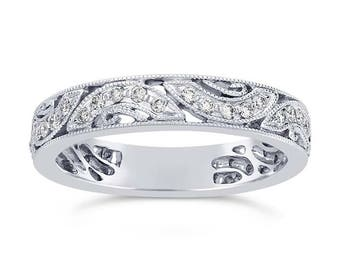 platinum ring features an open Art Deco design with thirty-four