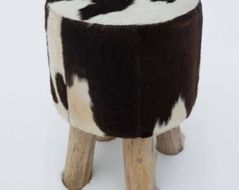 Coat stools made from cow skin / Bullhide round with wooden feet, black and white