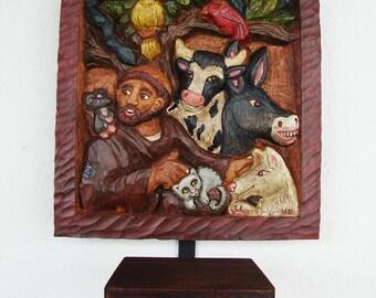 wood relief carving San Francisco with animals and candleholder / Relieve tallada en madera con San Francisco y los animales y portaveladora