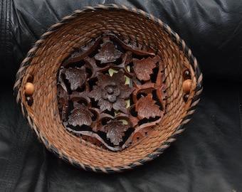 Pine needle basket on wooden base