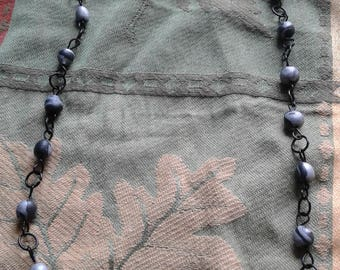 Handcrafted clay beads and black wire necklace