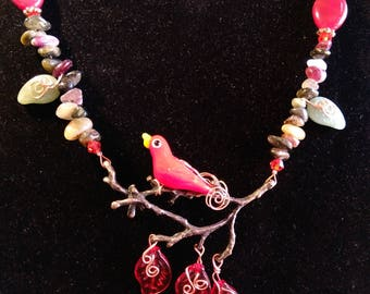 Red Glass Bird on a Bronze colored Branch....