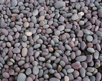 Hand picked bag of beach pebbles