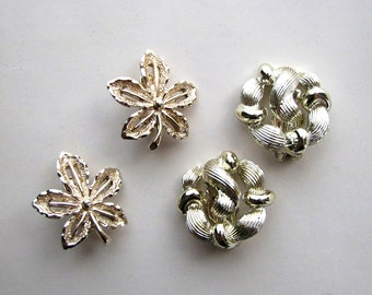 ivy leaf earrings by Sarah Coventry + abstract modern shape earrings by Star . 50s 60s clip on earrings, gold tone