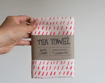 Linen Tea Towel - Dashes pattern in watermelon pink ecofriendly ink, hand screen printed in Melbourne