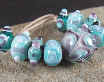 Aqua and purple encased stacked dots lampwork bead set