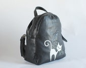 Backpack with white cat