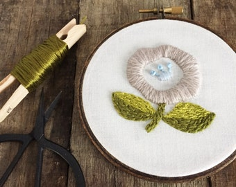 "Wool flower motif, 4"" embroidered and dark stained hoop"