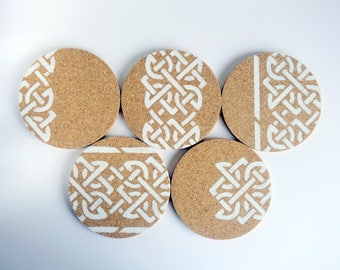 Round natural cork drink coasters. Contemporary, modern hand painted pattern in white. Unusual new home gift. Set of 5.