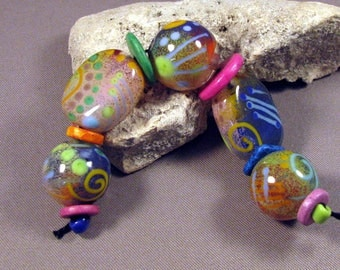 Lampwork Glass Beads Handmade by Mona Sullivan - Soft Enamels - Colorful Lampwork by Monaslampwork Bohemian Enamels Dots Squiggles on Clear