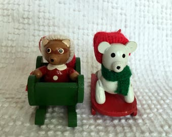 Vintage Set of 2 Painted Wooden Christmas Ornaments - Woodland Animals on Sleds with Knitted Caps - White Bear and Brown Racoon