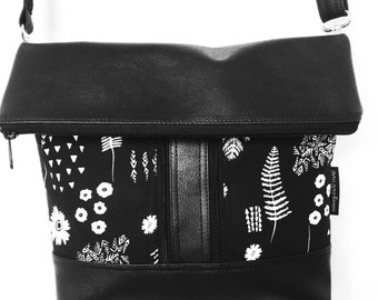 Cross body zipper bag featuring black and white modern botanical print