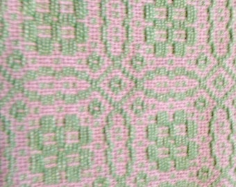 Handwoven table runner with green overshot pattern