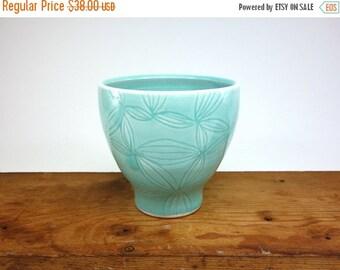 ON SALE Aquamarine glazed porcelain cup with carved leaf pattern